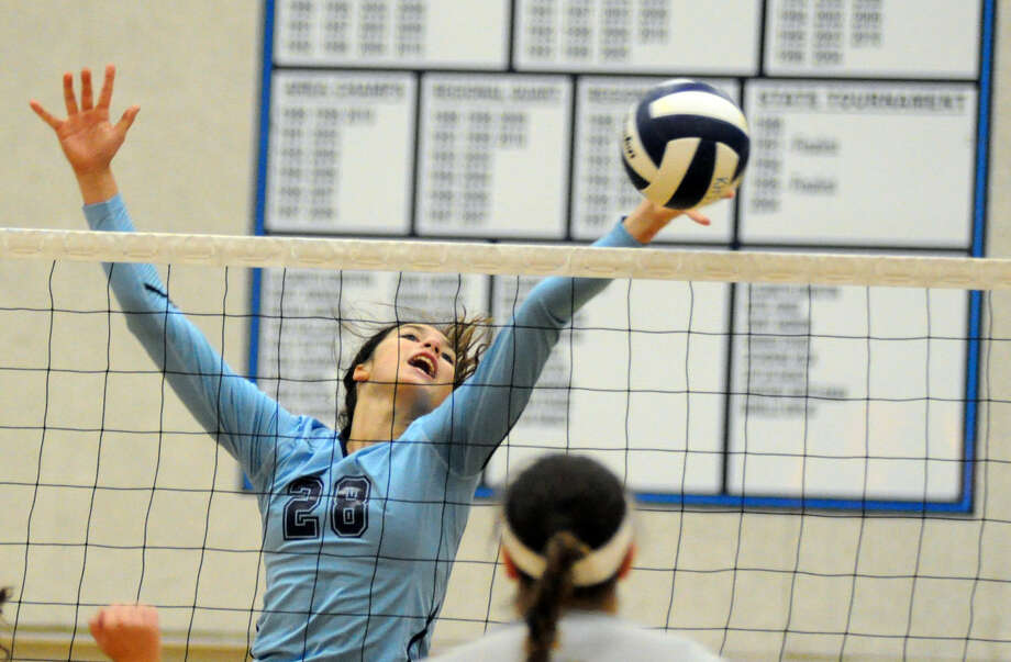 Kingwood's Sophie Zielinski reaches for a block in a non-district match on Tuesday at Kingwood High School. Photo: Keith MacPherson