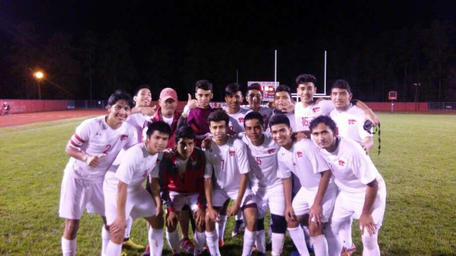 The Splendora men's soccer team poses for a picture after a game earlier this season.