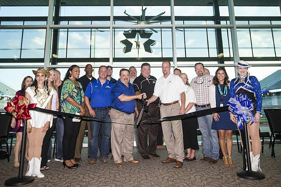 Staff photo by Andrew Buckley New Caney ISD and Texan Drive officials cut the ribbon during the Texan Drive Stadium ribbon cutting and open house Sep. 9, 2014, in Porter. Photo: ANDREW BUCKLEY