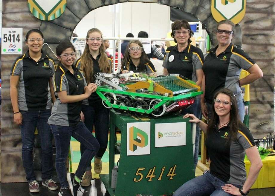 Pearadox ladies include (from left) Ami Yang (mentor/NASA engineer), Lauren Dizon (Dawson High School), Emma Price (DHS), Lori Van Hoose (DHS), Laura Hood (mentor/NASA engineer), Lisa Like (parent volunteer) and Kara Boyer (mentor/Kinder Morgan engineer).