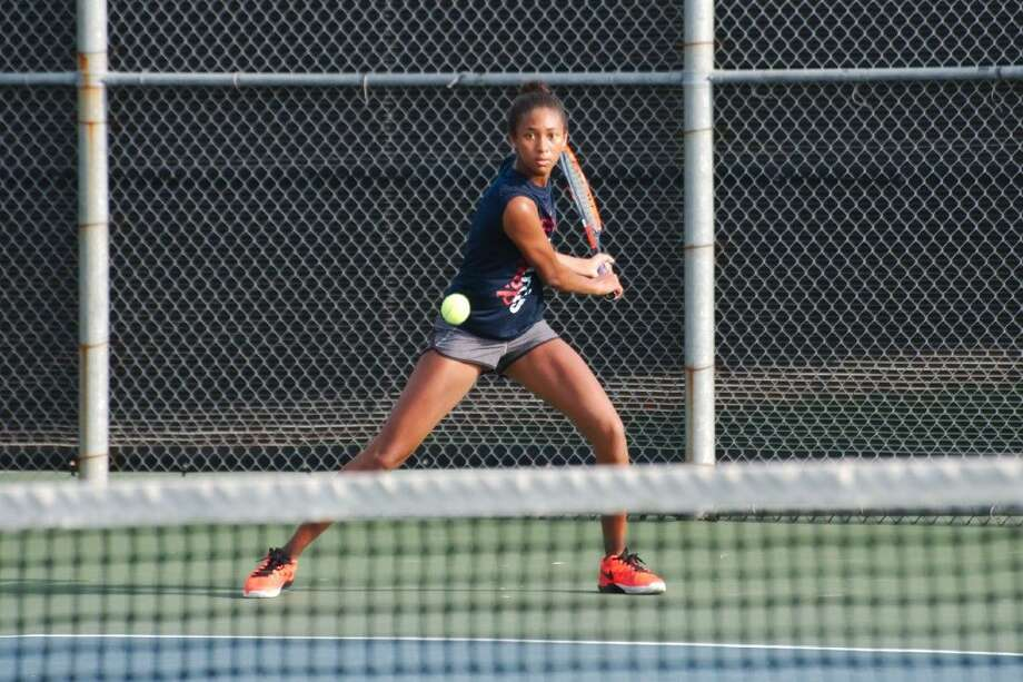 Dawson freshman Kyler Powe prepares to hit a backhand during the Region III-6A tennis tournament Thursday in Deer Park. Powe reached the championship match to earn a berth at the state tournament. Photo: Kirk Sides