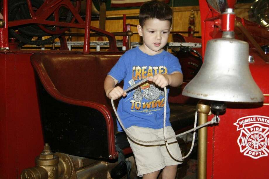 Noah Wilshusen rings the bell at the Antique Firehouse in Humble on Saturday, Sept. 6, 2014.