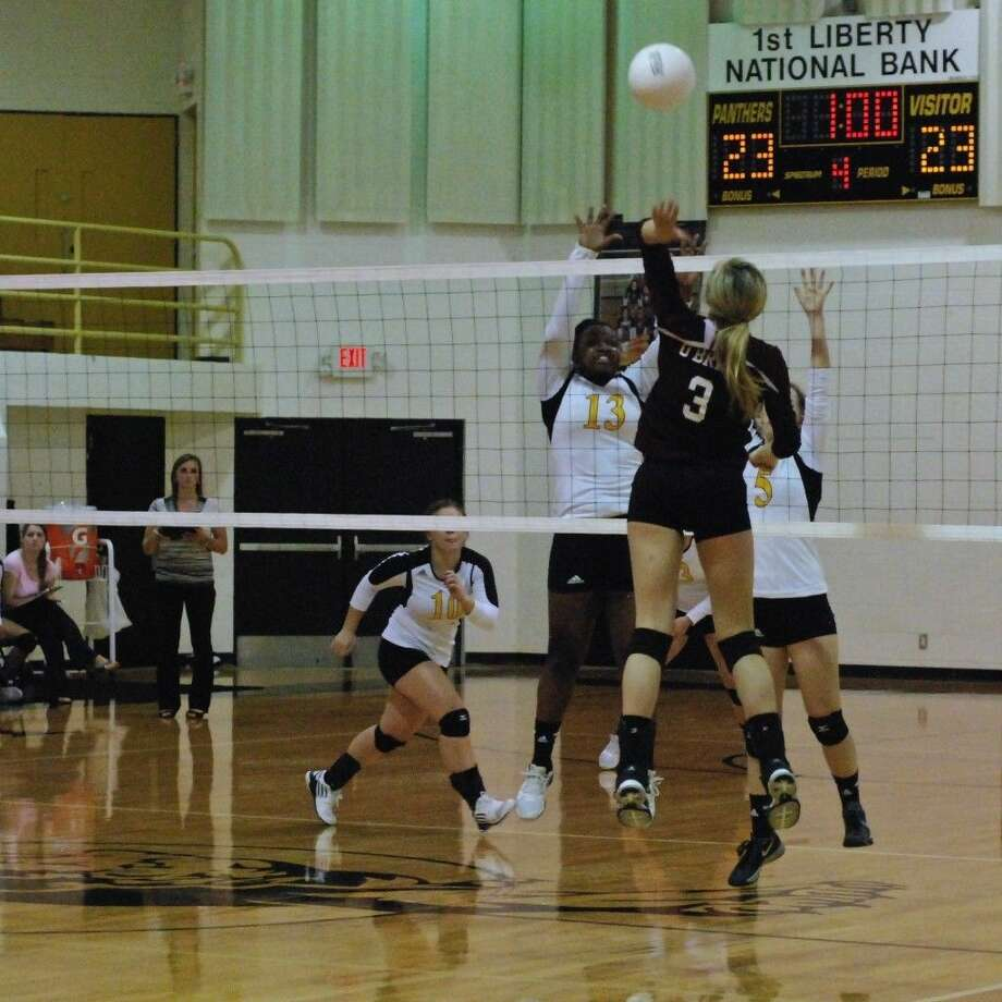 Photo by Casey Stinnett/Dayton NewsThe Tarkington LadyHorns won at Liberty Tuesday night, Sept. 9, in four sets, but the Panthers made them fight for every point. Liberty won their first set 25-11, then Tarkington squeezed out wins in the next three sets: 25-23, 30-28, and 25-23. Denise Booker (13) made 8 blocks for Liberty, and Madi O'Brien (3) scored 16 kills for Tarkington. Photo: Casey Stinnett