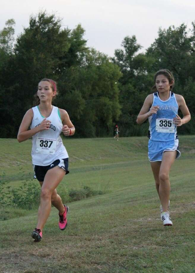 SubmittedAlaina Hergott and Aliana Hale compete for Kingwood at the Montgomery Moonlight Madness meet last Thursday.