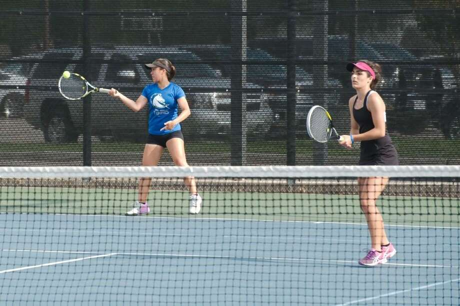 Clear Springs' Melody Duong hits a forehand return while teammate Aava Azad stays focused at the net durning girls' doubles action at the Region III-6A tennis tournament. Duong and Azad reached the finals to advance to the state tennis tournament. Photo: Kirk Sides