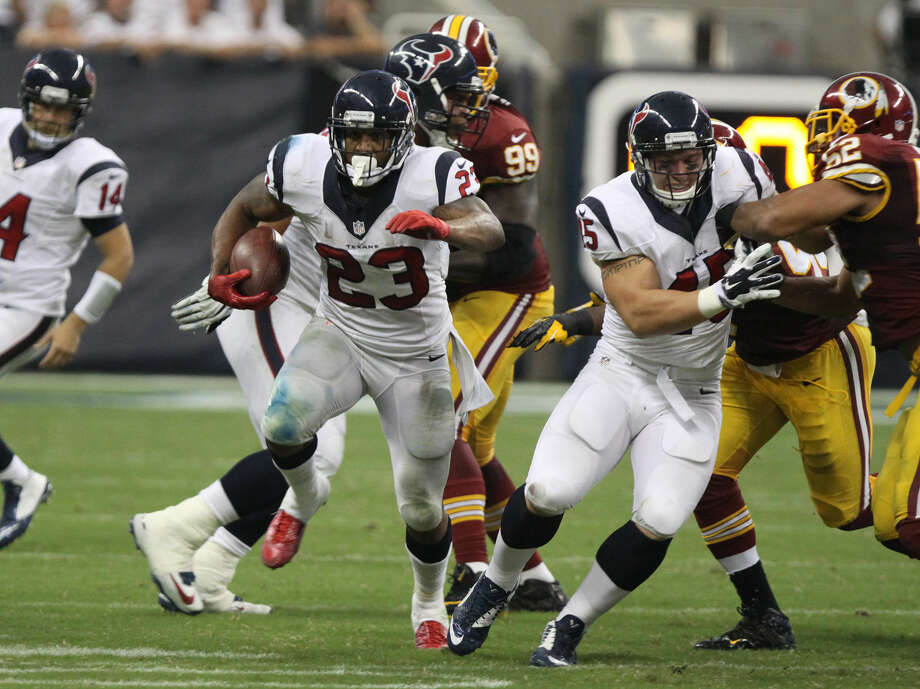 Houston Texans Arain Foster runs the Washington Redskins at NRG Stadium in Houston, Texas on Sunday, September 7, 2014. Photo: Alan Warren