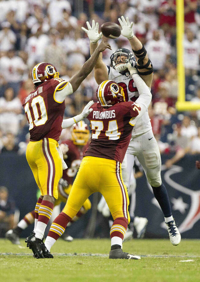 Houston Texans defensive end J.J. Watt (99) bats down a pass by Washington Redskins quarterback Robert Griffin III (10) during the second half of an NFL football game Sunday. Houston defeated Washington 17-6. Go to HCNpics.com to view more photos from the game. Photo: Jason Fochtman