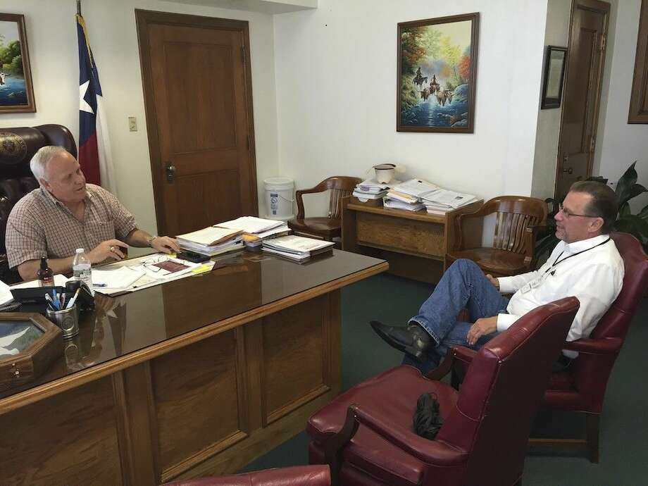 Liberty County Judge Jay Knight visits Tuesday afternoon, April 19, with Emergency Management Coordinator Tom Branch about the most recent floods. Cleveland, Plum Grove and areas in the northern part of the County were hardest hit. Photo: Casey Stinnett