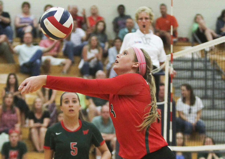The Woodlands' Sophie Walls makes a pass during a high school volleyball game Tuesday. To view or purchase this photo and others like it, visit HCNpics.com. Photo: Jason Fochtman