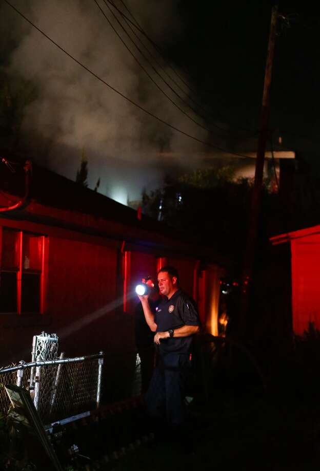 Firefighters respond to a house fire on Staples Street, Wednesday, Oct. 5, 2016, in Houston. The structure had been abandoned for two years, but it was filled with the previous occupant's belongings, according to District Chief D. L. Elliott. No injuries were reported. ( Jon Shapley / Houston Chronicle )