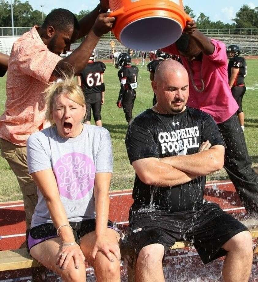 COHS Coach Scott Taylor gets doused with icy water, as the stand-in for Asst. Principal Matthew Bess, who had already taken the ALS challenge. Asst. Principal Lynette Jackson gasps as the overflow gives her a preview of her own icy fate on Thursday, Sept. 4. Photo: Submitted Photo