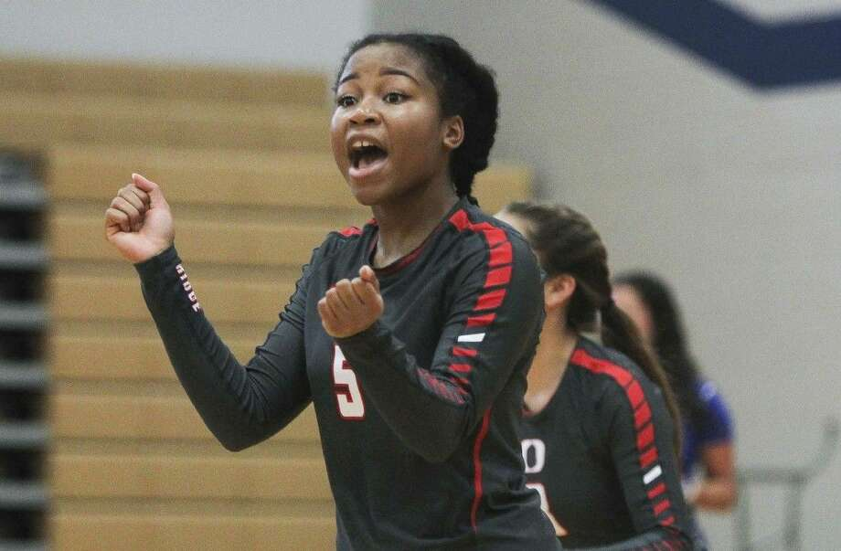 Oak Ridge's Rhyan Johnson celebrates a point in the first set of a high school volleyball game Tuesday. To view or purchase this photo and others like it, visit HCNpics.com.
