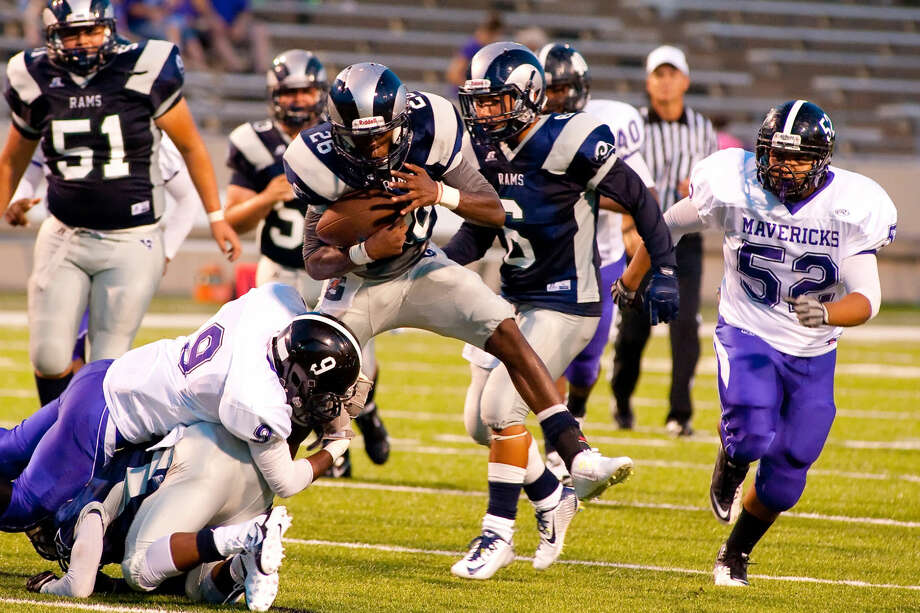 Cy Ridge quarterback D'Angelo Ellis tries to avoid Morton Ranch defenders in the Rams' 16-0 loss Saturday at Pridgeon Stadium. Photo: Tony Gaines/HCN