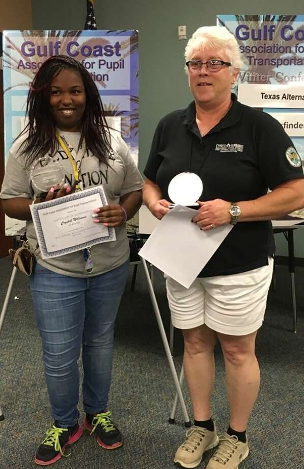 Attendant Crystal Williams, left, and driver Linda Hair of the Eldridge Transportation Center placed third in the Regional School Bus Safety Road-e-o special needs competition.