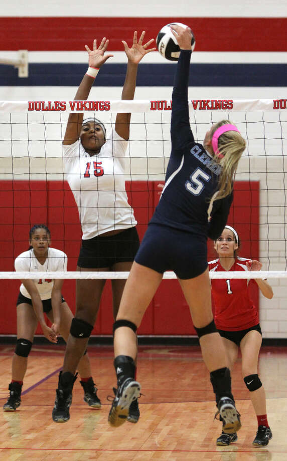 Clements' Lauren Stifflemire spikes against Dulles' Chandler Marshall during their 2014 District 23-6A match at Dulles High School in Sugar Land. The Lady Vikings defeated Alvin on opening night of the 2015 season, while the Lady Rangers split with Pearland and Stratford.
