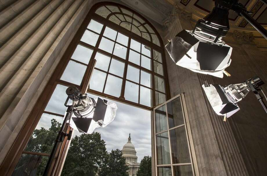 In this Sept. 9, 2013 file photo television news lights await the start of activity on Capitol Hill in Washington as both houses of Congress return to full legislative session. Lawmakers are streaming back to Capitol Hill after this year's summer vacation for an abbreviated September session in which feuding Democratic and Republican leaders promise action to prevent a government shutdown while holding votes aimed at defining the parties for the fall campaign. Republicans control the House and want to pad their 17-vote majority, so they intend to follow this simple rule: first, do no harm Photo: J. Scott Applewhite