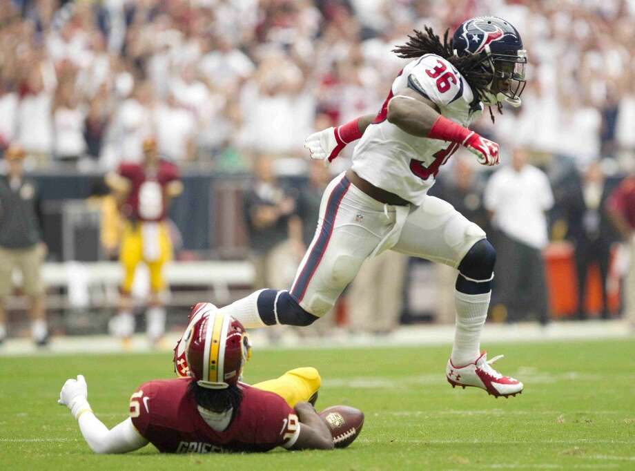 Houston Texans safety D.J. Swearinger (36) leaps over Washington Redskins quarterback Robert Griffin III (10) after a sack in the first half of an NFL football game Sunday. Houston defeated Washington 17-6. Go to HCNpics.com to view more photos from the game. Photo: Jason Fochtman