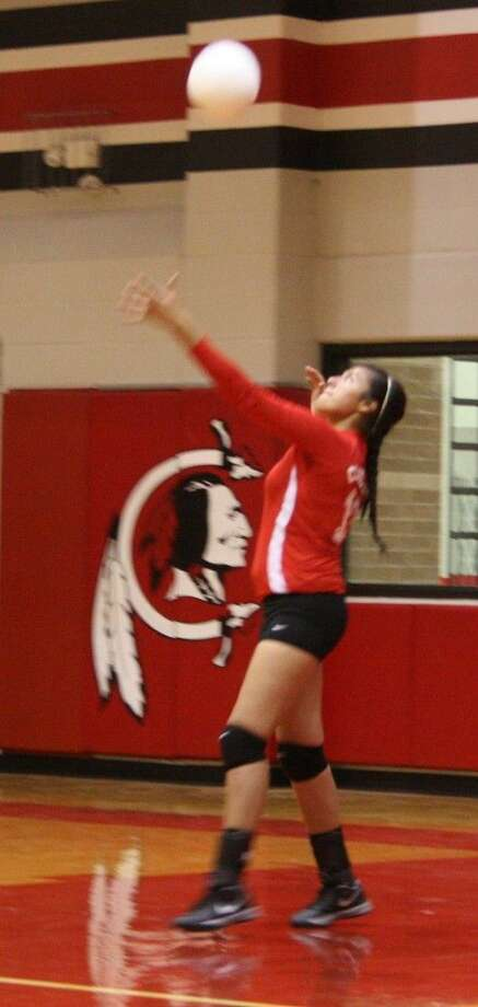 Olivia Rivera of the Lady Indians waits for the ball to approach for a serve. Photo: Staff Photo By Jacob McAdams