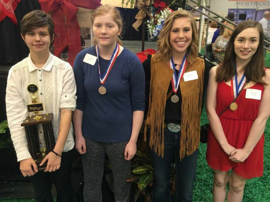 Students pose with their awards from the Houston Livestock Show & Rodeo.