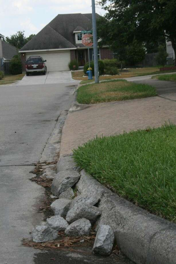 Busted and crumbling curbs such as this one are commonplace in the Falcon Ranch area and its surrounding areas. Many HOA's in the area have complained to Fort Bend County.