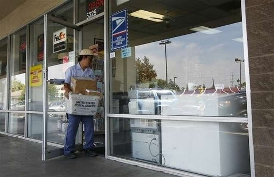 Mail is delivered on Monday to a Postal Annex store in Sacramento, Calif., that is listed as one of two addresses associated with a nonprofit organization known as the Center for Medical Progress. Despite its name, the group employs no scientists or physicians engaged in advancing medical progress. Photo: Rich Pedroncelli