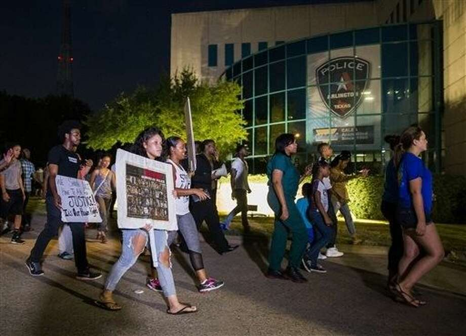 Protesters march outside the Arlington Police Department in Arlington, Tuesday, demanding that officer Brad Miller be charged with a crime. Photo: Ashley Landis