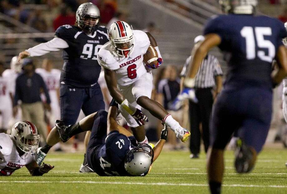 Atascocita running back Patrick Taylor Jr. runs during a game last season for the Eagles. Taylor will not make his decision on where he will play college football until October.