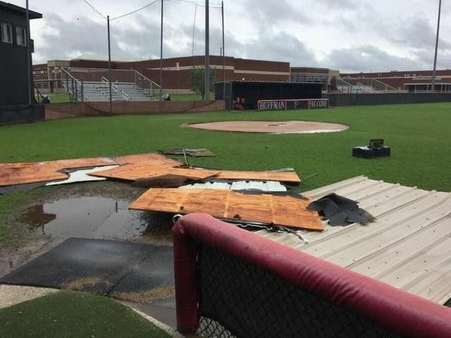 Parts of the roof from the Huffman baseball press box lay on the field after a strong storm blew through the area over the weekend.