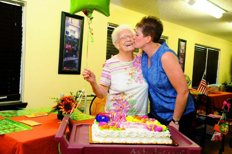 Jean Culver, who turned 102, receives a kiss on her birthday from her granddaughter Dawn Hamerik on Monday, Aug. 10, at the Tomball Nursing Center.