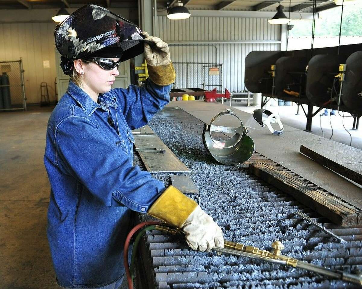 San Jacinto College welding instructor Amber Tyler prepares to work in the welding training lab at the North Campus. The San Jacinto College graduate enjoys the pride of skilled craft workmanship that goes along with welding. Photo credit: Rob Vanya, San Jacinto College marketing, public relations, and government affairs department.