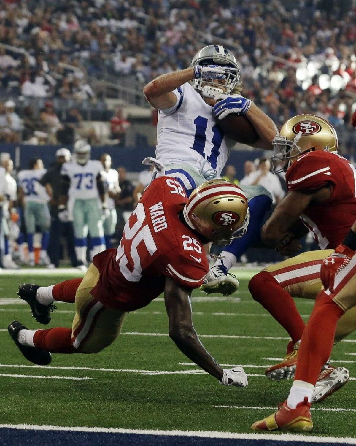 AP photoDallas Cowboys wide receiver Cole Beasley (11) is tackled by the 49ers' Jimmie Ward, left, and strong safety Antoine Bethea. The 49ers won 28-17.
