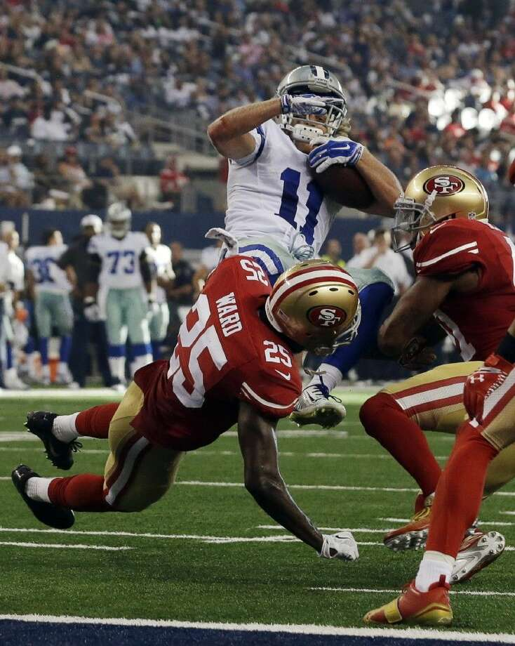 AP photoDallas Cowboys wide receiver Cole Beasley (11) is tackled by the 49ers' Jimmie Ward, left, and strong safety Antoine Bethea. The 49ers won 28-17. Photo: LM Otero