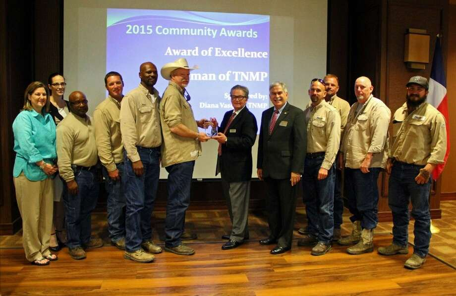 The Friendswood Chamber of Commerce Community Award of Excellence was presented to the linemen from the Texas New Mexico Power Company. Photo: Kristi Nix