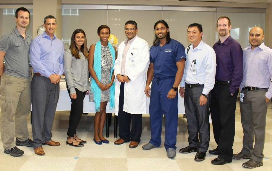 From left: Alex Garbino, M.D., PhD; Oscar Martinez, M.D.; Sofia Farooqi, DO; Dianna Bryan, M.D.; Nadim Islam, M.D., Medical Director, Memorial Hermann Southeast Hospital; Abdulla Kudrath, M.D.; Dien Bui, M.D.; Paul Sheehan, M.D., Medical Director, Memorial Hermann Convenient Care Center in Pearland; and Samar Yusuf, DO, Assistant Medical Director Memorial Hermann Southeast Hospital