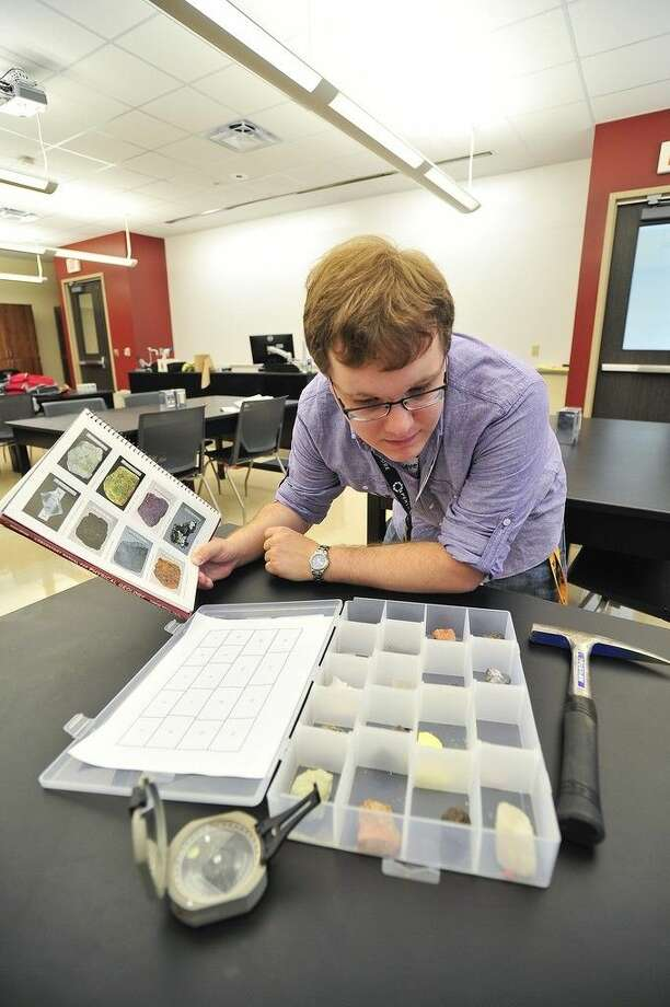San Jacinto College geology professor JohnFranklin Dzuryak prepares a class lesson in a science lab. Geology and other science classes are available on weekends at all three San Jacinto College campuses. Photo credit: Rob Vanya, San Jacinto College marketing, public relations, and government affairs department.