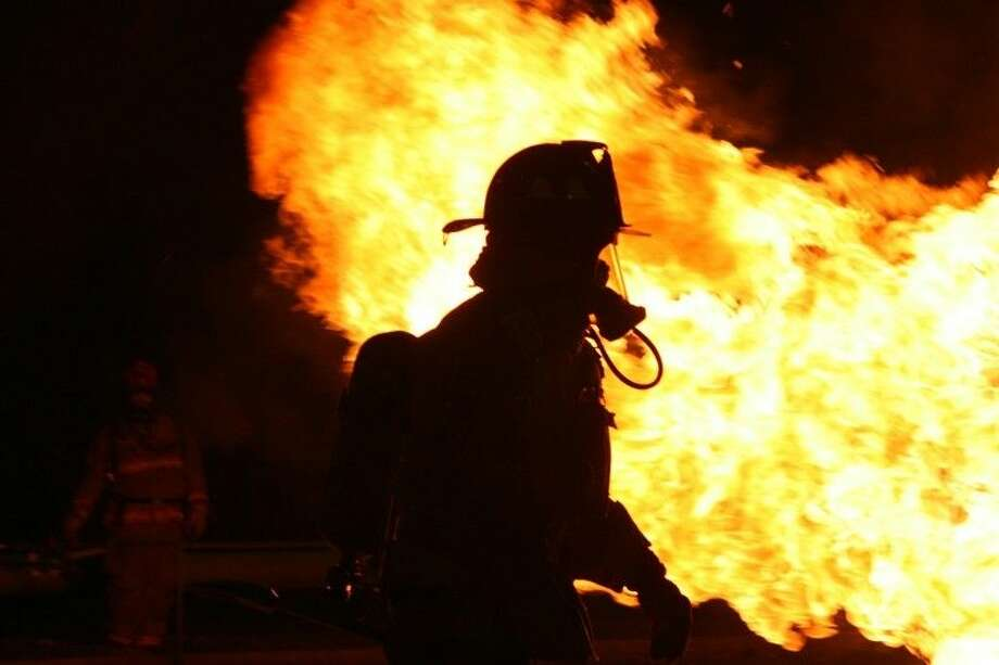 A College of the Mainland student trains in the COM Fire Academy, now open for enrollment.