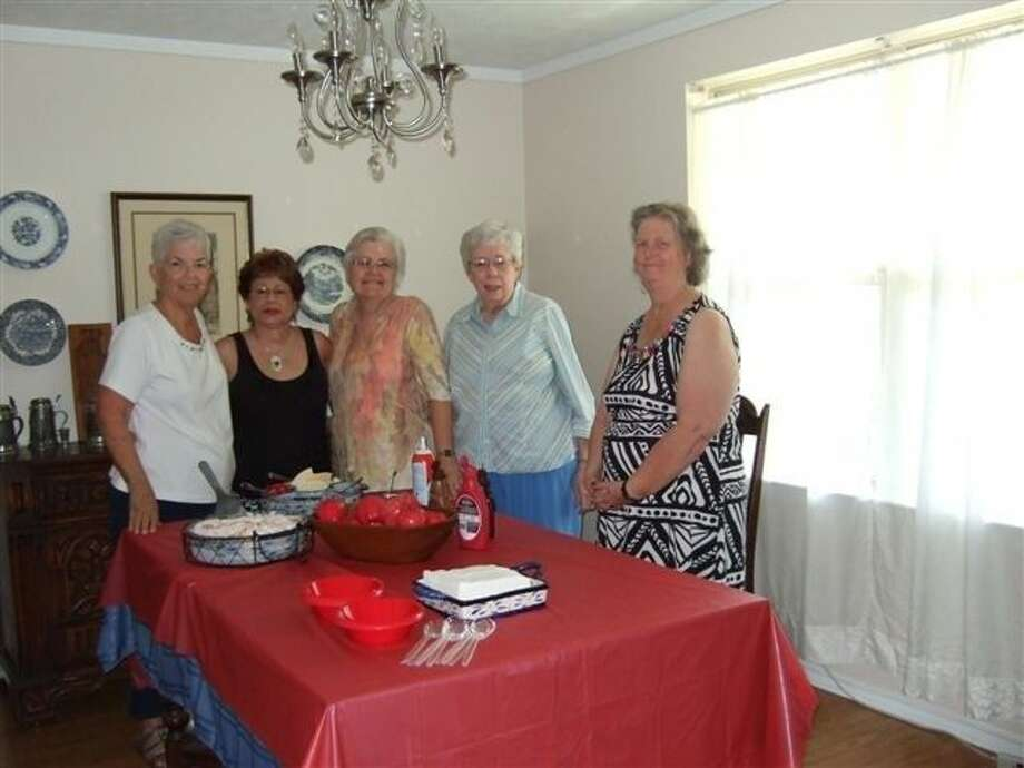 Pictured with refreshments were hostess Jean Kern of Friendswood; Julie Hoover of Houston; Linda Abbott of Friendswood; Dian Thomasson of Alvin; President Diana Embrey of Friendswood..