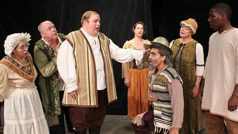 """Don Miguel Cervantes is crowned with the Golden Helmet of Mambrino in Pasadena Little Theatre's """"Man of La Mancha"""". From left to right, Front Row: Katie Reed, David Blystone, Emilio Cevallis, Jared Cadoreis. Back Row: Revis Bell, Connie Musler, Janet Elayne."""