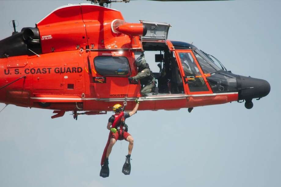 A U.S. Coast Guard helicopter performs a simulated rescue during the Houston Ship Channel's 100th Birthday Centennial Family Fest Saturday, Sept. 6. Photo: Kirk Sides