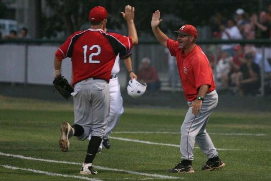 Memorial head coach Jeremy York reacts with excitement as he greets Patrick McNulty.
