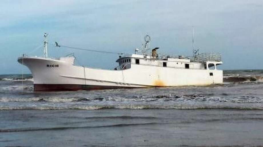 A derelict vessel, Rich, aground on Sargent Beach Thursday, Sept. 4, 2014, located about 20 miles south of Freeport. The vessel was found and reported by a passing vessel, the Lady Glenda, on Sept. 2 and it eventually went aground Sept. 4. (U.S. Coast Guard photo by Petty Officer 1st Class Christina White)