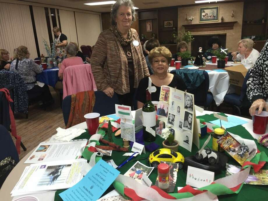 Pictured is Theta Master's President Diana Embrey of Friendswood with member Julie Hoover of Houston at their table decorated for Hungary.