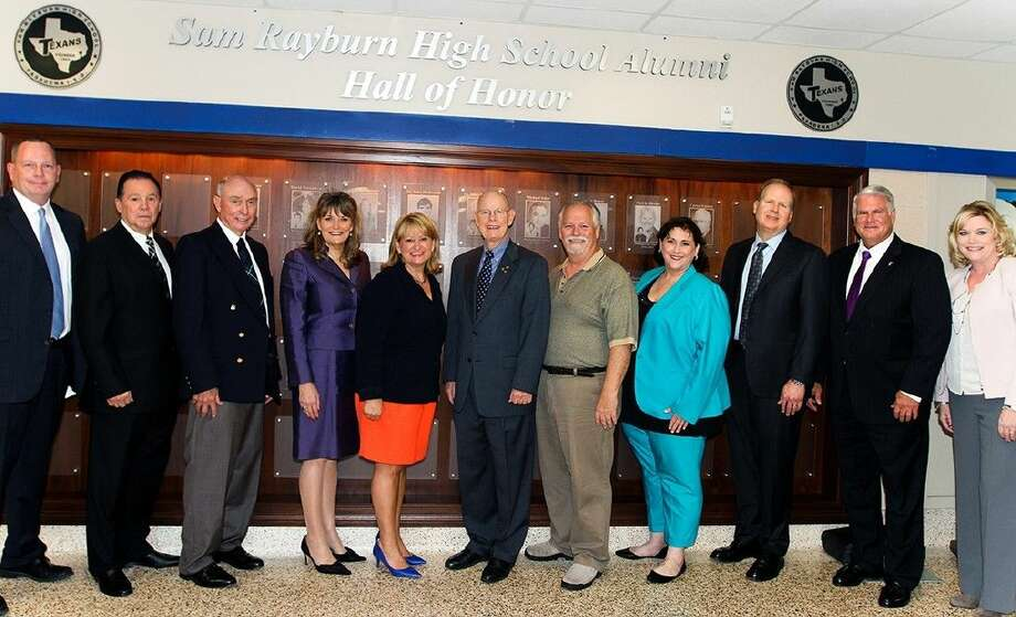 Pictured (from left to right): Rayburn Principal Robert Stock, Travis Jaggers, Al Campo, Sr., Nanci Westbrook Wilson, Cindy Marion, Dr. Jay Dunahoo, Phil Konstantin, Kelli Zohar-Davis accepting on behalf of the late Georgeann Zohar, Mitchell Eggers, and Judge John Clinton and School Superintendent Dr. DeeAnn Powell.