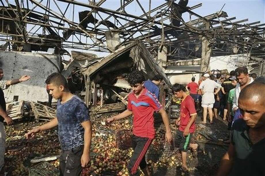 The massive truck bomb ripped through the popular Baghdad food market in the Iraqi capital's crowded neighborhood in the early morning hours on Thursday, killing tens of people, police officials said, in one of the deadliest single blasts in the capital in years. Photo: Karim Kadim