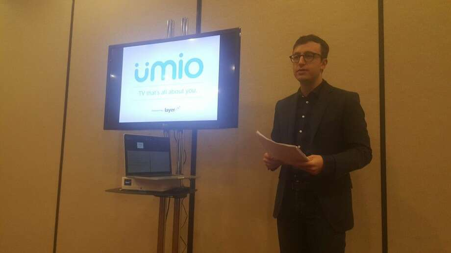 Eric Kuhn, chief marketing officer for Layer3TV, delivers a presentation about Umio, a new cable company, at the Umio launch event in Kingwood Thursday, April 21.