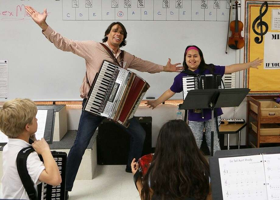 Carleston Elementary student Angie Alaniz and international touring accordionist Alex Meixner take in the applause after a duet.