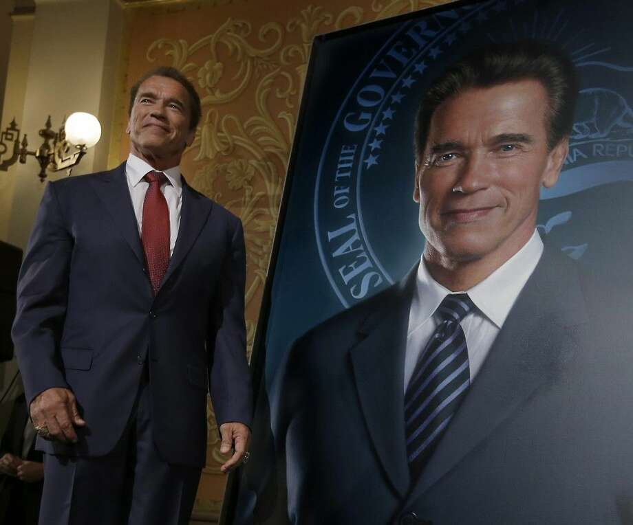 AP photo by Rich PedroncelliFormer Gov. Arnold Schwarzenegger poses with his official portrait after it was unveiled at the Capitol in Sacramento, Calif., Monday, Sept. 8, 2014. The photograph-like giant image of the former governor was done by Austrian artist Gottfried Helnwein and will hang on the third floor of the Capitol. Photo: Rich Pedroncelli