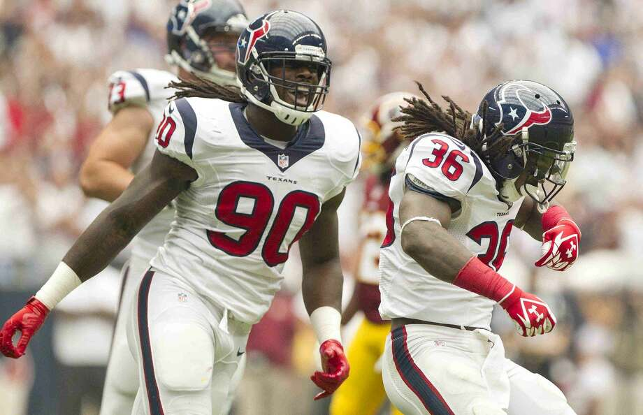 Houston Texans safety D.J. Swearinger (36) celebrates with outside linebacker Jadeveon Clowney (90) after sacking Washington Redskins quarterback Robert Griffin III (10) in the first half of an NFL football game Sunday. Houston defeated Washington 17-6. Go to HCNpics.com to view more photos from the game. Photo: Jason Fochtman