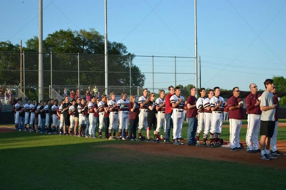 Teachers join Cy-Fair baseball players on the field for the national anthem prior to the Bobcats' April 15 Teacher Appreciation Night.