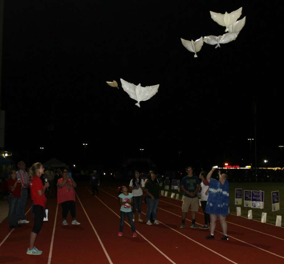 Dove balloons are released at North Liberty County Relay for Life in memory of those who lost their lives to cancer. Photo: Jacob McAdams